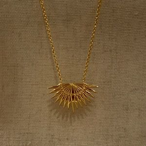 Rising sun charm, gold necklace.